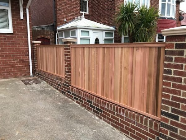 Our cedar wall panels are designed to fit in between any concrete post