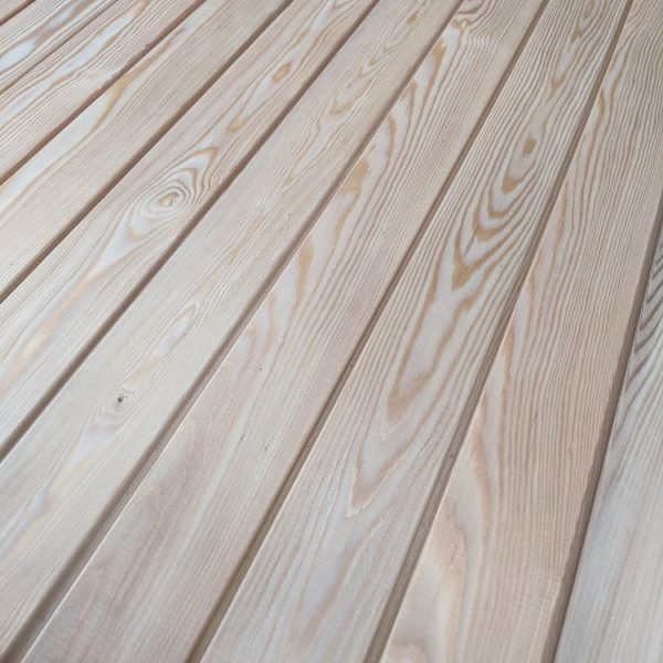Our Siberian Larch interlocking battens create a stylish and modern feature to any home.