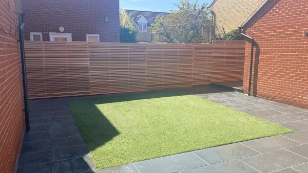 Our standard slatted cedar fence panels have been used on this contemporary garden project.