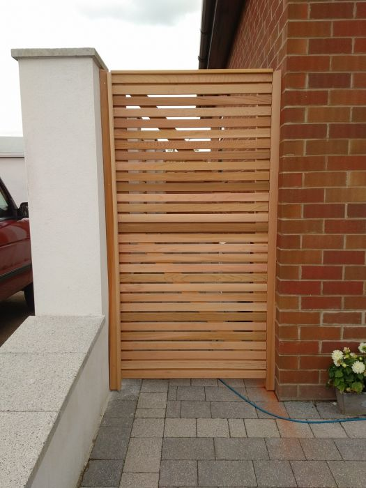 Our range of standard cedar fence slats have been used to create this stylish gate.