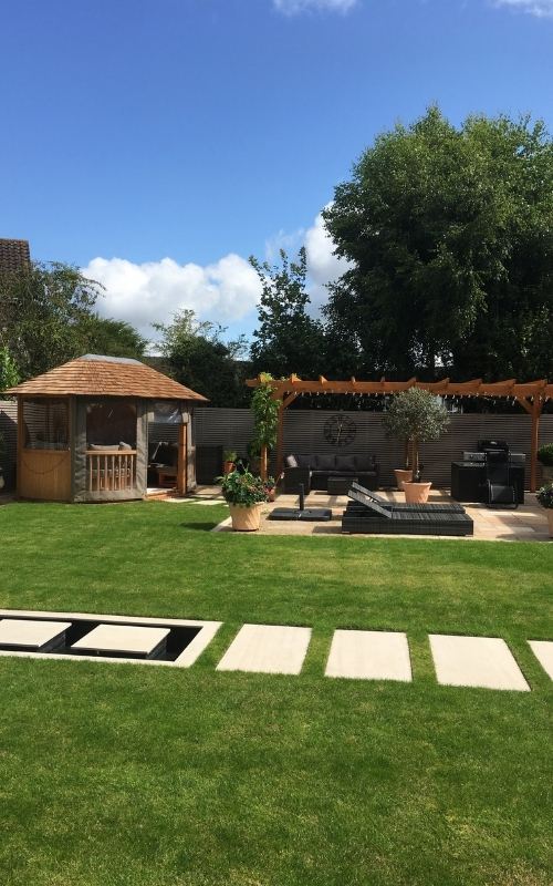 This garden renovation project uses stained white pressure treated fence panels.